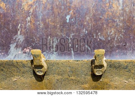 fragment of an iron ladle with two prong closeup for the construction bulldozer or for a loader and a blank space