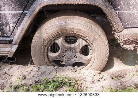 SUV got stuck in the mud, wheel closeup.
