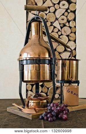 the copper still for distillation of grappa and essential oils.