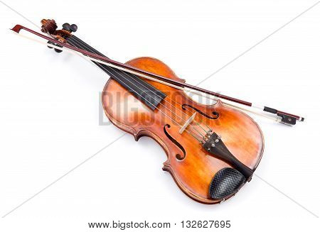 Top view of violin and bow on white