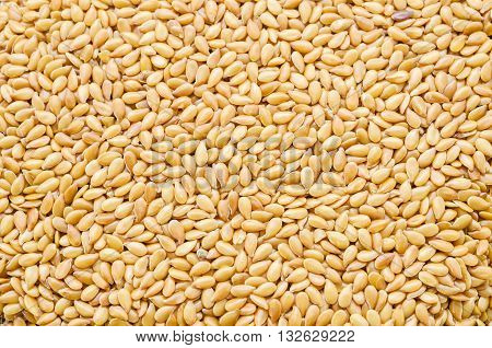 Yellow Flax seeds Linseed Lin seeds close-up surface top view background