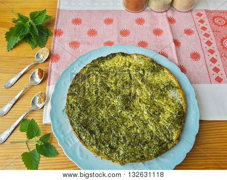 Greenery omelette with nettles and spices on plate