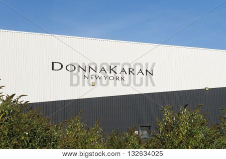 OLDENZAAL NETHERLANDS - OCTOBER 31 2015: Exterior of a Donna Karan warehouse. She is one of the most influential fashion designers in American fashion