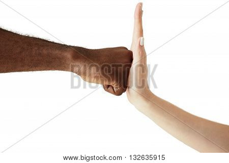 Close Up Of Two People Of Different Ethnicites And Cultures Holding Hands In Handshake Showing Respe