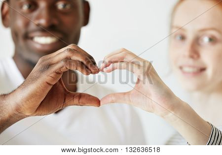 Black And White. Cropped Portrait Of African Man And Caucasian Woman Looking And Smiling At The Came