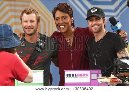 NEW YORK-JUNE 26: (L-R Dierks Bentley, TV personality Robin Roberts and Canaan Smith onstage at ABC's Good Morning America Summer Concert Series at Rumsey Playfield on June 26, 2015 in New York City.