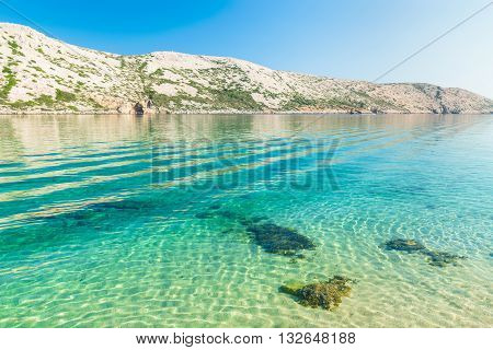 The pristine coastline and crystal clear water of the island of Rab Croatia.