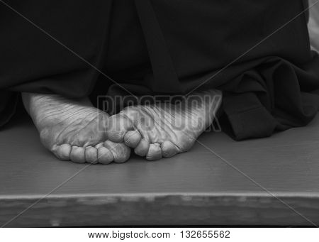 aikido fighter foot on the mat black and white photo