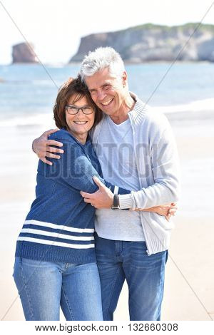 Senior couple embracing each other at the beach