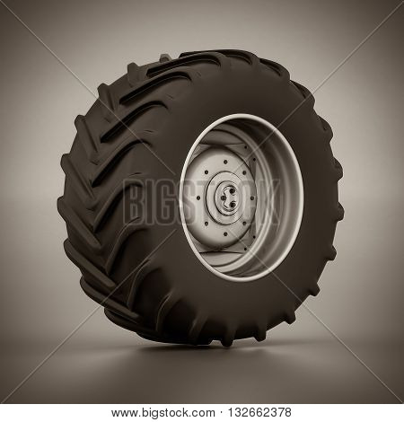 Tractor wheel isolated on gray background. black and white