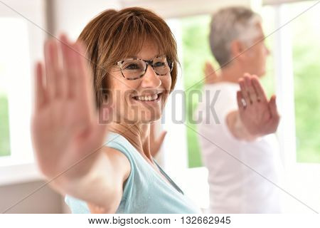 Senior people doing stretching exercices