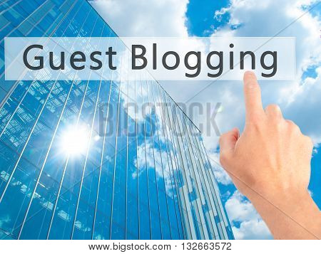 Guest Blogging - Hand Pressing A Button On Blurred Background Concept On Visual Screen.