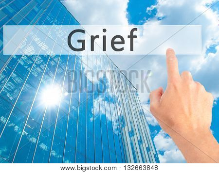 Grief - Hand Pressing A Button On Blurred Background Concept On Visual Screen.