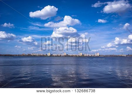 beautiful landscape of the cloudy sky above the river with reflection in water