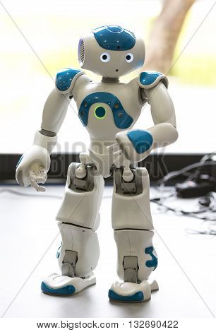 Sofia, Bulgaria - June 1, 2016: A small robot with human face and body - humanoid. Artificial Intelligence - AI. Blue robot.