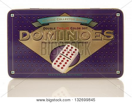 Winneconne WI - 31 May 2016: Container of Dominoes on an isolated background