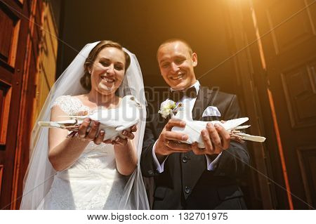 Cheery Wedding Couple With Pigeons At Hand