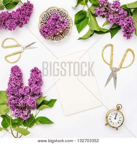 Lilac flowers notebook golden accessories. Flat lay sketchbook top view