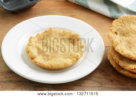 Healthy home made gluten free biscuits on white plate in horizontal format