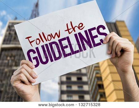 Follow the Guidelines placard with urban background