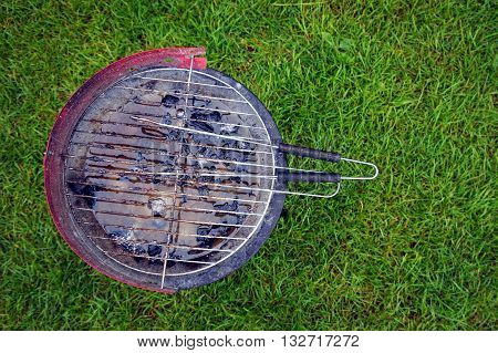 A Used Barbecue Full Of Rain Water