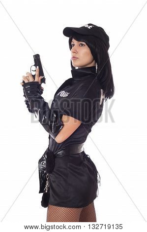 Portret of beautiful sexy policewoman with handcuffs in a black uniform that aiming a gun. Iisolated on white.