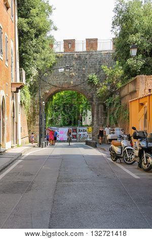 Pisa Italy - June 29 2015: People on the picturesque street of old town. Province Pisa Tuscany region of Italy