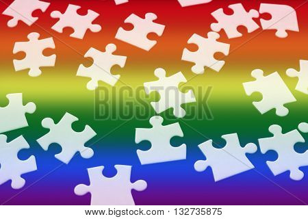 white puzzle with rainbow colors for gay pride