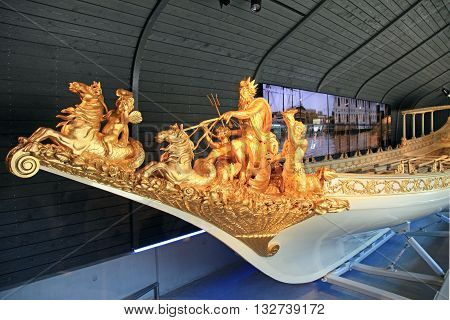 AMSTERDAM, NETHERLANDS - MAY 6, 2016: Gold statue on bowsprit of baroque dutch medieval royal boat in The National Maritime Museum, Amsterdam, Netherlands.