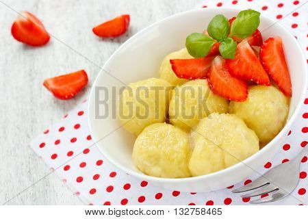 Lazy dumplings with cottage cheese and strawberries summer dessert selective focus