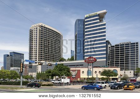 DALLAS USA - APR 7: Crossroads with highrise buildings in the city of Dallas. April 7 2016 in Dallas Texas United States