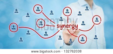Synergy opportunity concept. Manager (businessman) connect team members with text synergy cooperating team connected with this text.