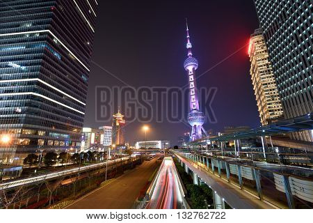 SHANGHAI CHINA - MARCH 20: Pudong district night view on March 20 2016 in Shanghai China. Pudong is a district of Shanghai located east of the Huangpu River.