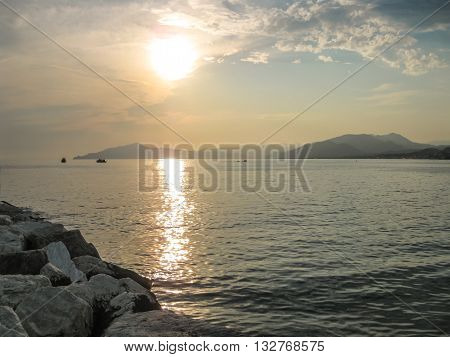 Sunset over the sea in the famous beach of the Bay of Fairy Tales in Sestri Levante, Province of Genoa in Liguria, Italy. poster