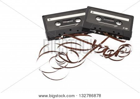 two pulled out cassette tape isolated on a white background
