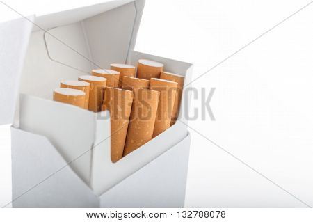 Open Pack Of Cigarettes Stands Vertically Over White Background