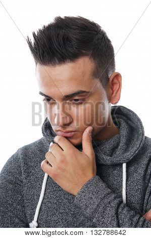 young turkish man with a thoughtful or sad look on his face