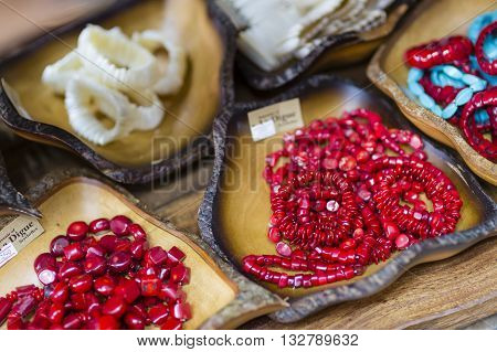 LA DIGUE - AUGUST 13: Red plastic bracelets at a souvenir shop in La Digue, Seychelles on August 12, 2014