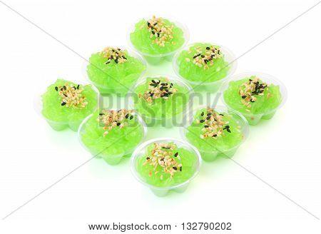 Square of pandanus flavored sweet translucent gelatinous rice.