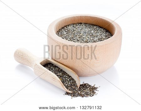 Chia seeds in wooden bowl with scoop isolated on white