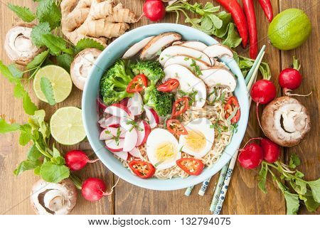 Asian ramen noodle soup with fresh veggies and hardboiled egg
