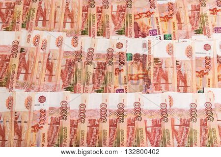 abstract background of banknotes nominal value of 5000 rubles