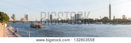 Cairo Egypt - May 26 2016: Panoramic view of central Cairo at dusk the Nile river the Island of Zamalek and the Cairo Tower.