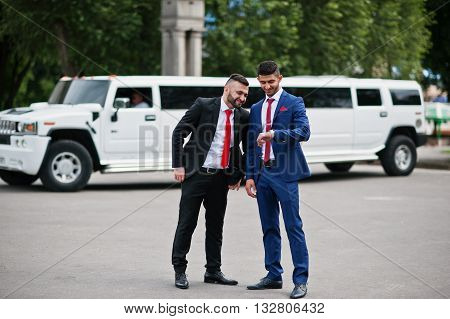 Kyiv, Ukraine - June 25, 2015: Two Stylish Arabic Businessman Mans In Tuxedo Background White Hummer