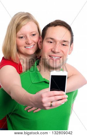 Young Couple In An Embrace Taking A Self Portrait