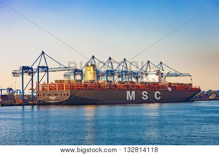 GDANSK, POLAND - JUNE 03, 2016: The MSC Maya is currently one of the world's largest container ship during loading at DCT Gdansk Container Terminal. Length 395m, beam 59m, total capacity 19 224 containers.