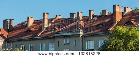 Chimneys on the roofs of old houses fitted with heating stoves. The historic settlement of railwaymen in Chelm near Lublin in Poland.