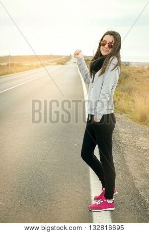 the beautiful lovely girl was photographed on the road on the road