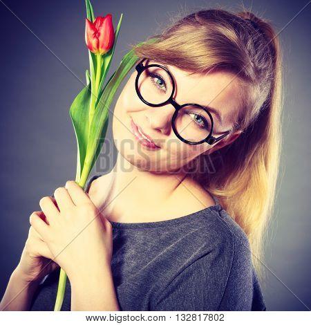Nerdy Girl Sniffing Flower.