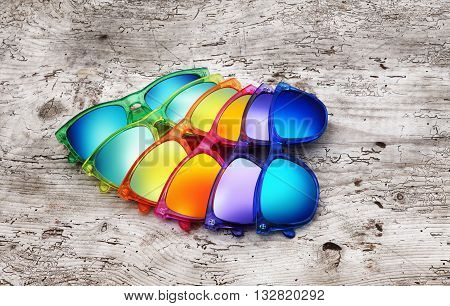 group of sun glasses on wodden background